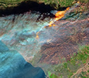 Satellites can quickly detect and monitor wildfires from space, like this 2017 fire that encroached on Ventura, California.