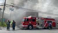 2 NY firefighters injured in commercial fire