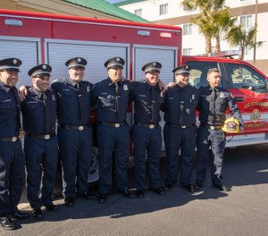 Several of the new personnel for the Victorville Fire Department are seen posing in front of a new squad vehicle. (Photo/City of Victorville)