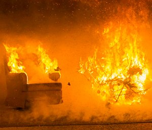 Flames engulf the wall and ceiling of a room as well as items in the room 35 seconds into the ignition of a Christmas tree during a test burn by the fire protection engineering lab at the Worcester Polytechnic Institute. (Matthew Burgos/Worcester Polytechnic Institute via AP)