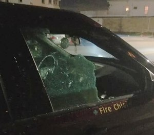 Fall River Fire Chief John Lynch said his vehicle was hit with a brick outside his home Friday night.