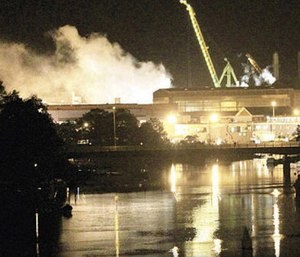 Smoke rises from a dry dock as fire crews respond Wednesday, May 23, 2012 to a fire on the USS Miami SSN 755 submarine at the Portsmouth Naval Shipyard. (Photo/AP)