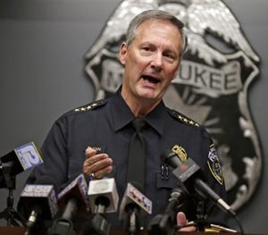 Chief Edward Flynn announces at the Muncipal Court Building, in Milwaukee Wednesday, Oct.15, 2014, the firing officer Christopher Manney who fatally shot Dontre Hamilton at Red Arrow Park. Flynn said Manney ignored his training and police policy. (AP Image)