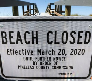 Pinellas County posted beach closure signs in March. On Thursday, the Pinellas County Commission will consider opening parts of the beaches for exercise, despite law enforcement's resistance.
