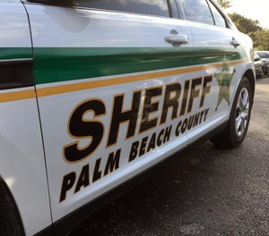 A Palm Beach County Sheriff's deputy was pinned between two vehicles as a suspect tried to flee law enforcement in a pickup truck. (Photo/TNS)