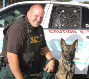 Deputy Scott Cronin and K-9 Vise were stabbed while attempting to arrest a man who had broken into a home and then barricaded himself inside. (Photo/Polk County Sheriff's Office)