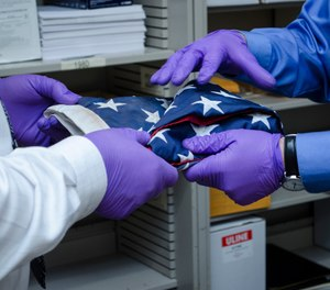 Detectives enlisted the help of Washington State Patrol Forensic Scientist William Schneck to examine particulate debris on the flag and compare it with known debris samples collected at the World Trade Center shortly after the terrorist attacks. (Photo/Steve Paxton)