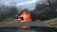Video: Flaming van narrowly misses responding officer