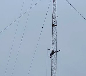 A Pensacola man scaled a 365-foot-tall tower in an attempt to evade police. (Photo/TNS)