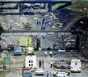 The grassy banks of Middlebelt Road near I-94 were scorched black. Fiery wreckage, luggage and bodies were strewn throughout the roadway.