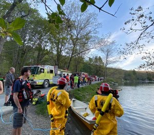 Members of the Fly Creek, N.Y., fire department participate in a multi-agency water rescue drill in May.