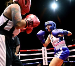 Los Angeles Police Officer Deirdre Fonseca, right, sizes up her opponent, Los Angeles County Sheriff's Deputy Destiny Moreno. (Photo/TNS)
