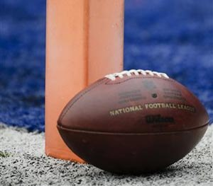 A football sits near the pylon marking the end zone as teams warms up before an NFL football game between the New York Giants and the San Francisco 49ers Sunday, Nov. 16, 2014, in East Rutherford, N.J. (AP Image)