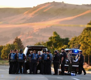 Police investigate at the scene of a shooting at the Morgan Hill Ford Store in Morgan Hill, Calif., Tuesday, June 25, 2019. Police say the shooting has killed at least two people in what may be a workplace confrontation. (AP Photo/Nic Coury)