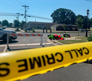 The scene of a shooting and vehicular assault Monday left four people dead and multiple wounded in Charlotte. (Photo/AP Photo/Sarah Blake Morgan)