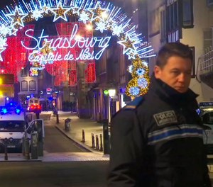 The attack near a French Christmas market left at least 4 people dead and 11 wounded. Police are still searching for the gunman