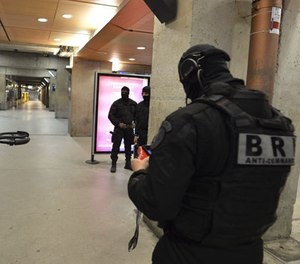 A member of the Research and Intervention Brigades (BRI) controls a drone during a terror attack exercise at the Gare Montparnasse railway station in Paris, Wednesday, April 20, 2016.