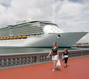The Freedom of the Seas cruise ship is seen docked at the San Juan Port, Puerto Rico, Wednesday, June 20, 2007. (AP Photo/Andres Leighton)