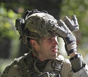 An FBI agent with combat gear and night vision optics exits a wooded area at Buck Hill Falls in Barrett Township, P., where the search for Eric Frein continues Friday Sept. 26, 2014.