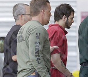 Esteban Santiago, right, accused of fatally shooting several people and wounding multiple others at a crowded Florida airport baggage claim, is returned to Broward County's main jail after his first court appearance, Monday, Jan. 9, 2017, in Fort Lauderdale, Fla. (AP Photo/Alan Diaz)