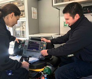 Ada County Paramedics Field Training Officer, Justin Raney, goes over equipment with EMT B MK Welch.