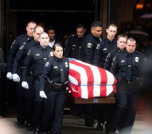 "Newman police officers carry the body of their slain colleague Cpl. Ronil ""Ron"" Singh during his funeral on Saturday, Jan. 5, 2019, in Modesto, Calif. According to authorities, prosecutors have charged Gustavo Perez Arriaga, who was in the United States illegally, with Singh's killing. (AP Photo/Noah Berger)"