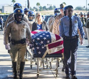 In this August 20, 2019 file photo, the flag-draped casket of fallen California Highway Patrol Officer Andre Moye Jr. arrives at Harvest Christian Fellowship church in Riverside, Calif. (Photo/TNS)