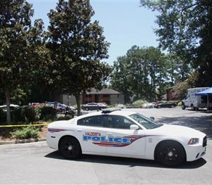 A police vehicle parks near the scene of an officer involved shooting, Friday, July 8, 2016, in Valdosta, Ga. (AP Image)