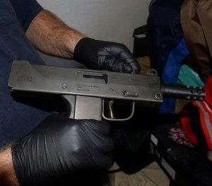 This Thursday, Dec. 7, 2017, photo shows a MPA 9mm gun, one of the 35 seized weapons during a gang crackdown in Stockton, Calif.
