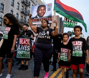 Protesters with Black Lives Matter protest in the Harlem neighborhood of New York, Tuesday, July 16, 2019.