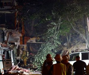 An apparent explosion in Columbia's Clary's Forest neighborhood had fire and rescue officials battling a three-alarm fire Wednesday in Columbia, Md. (Kevin Richardson/The Baltimore Sun via AP)