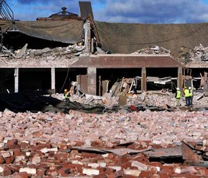 Inspectors assess damage around the area of a gas explosion that leveled a strip club in Springfield, Mass., on Nov. 23, 2012. (AP Photo/Jessica Hill, File)