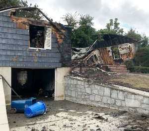 The house owned by Lawrence Police Officer Ivan Soto sits nearly burned to the ground on Jefferson Street, in Lawrence, Mass., Friday, Sept. 14, 2018.