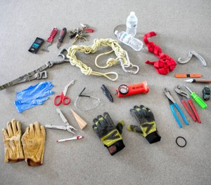 From pliers and screwdrivers to nylon webbing and multi-tools, your average firefighter is ready for anything and everything. (Photo/Tina Gianos)