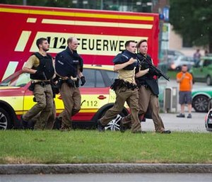 Policemen arrive at a shopping centre in which a shooting was reported in Munich.