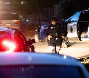 Police work a scene after a deadly shooting at the Gilroy Garlic Festival in Gilroy, Calif., Sunday, July 28, 2019. (AP Photo/Noah Berger)