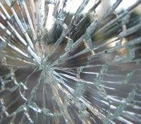 Ambulance window struck, cracked by BB gun shots
