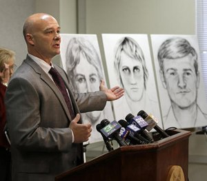 Sgt. Paul Belli gestures toward drawings of a suspected serial killer believed to have committed at least 12 murders across California in the 1970's and 1980's Wednesday, June 15, 2016.