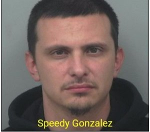 Speedy Gonzalez was charged with forgery, identity theft and theft by deception.(/Photo/Gwinnett Police Department)