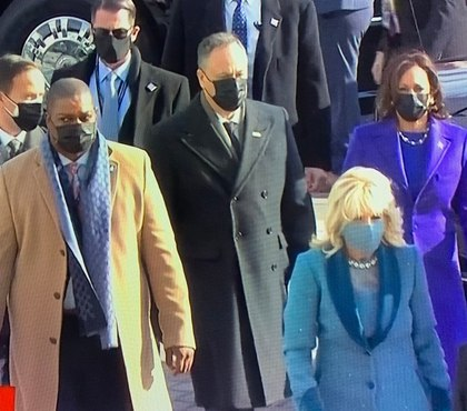 US Capitol Police officer Eugene Goodman escorts Kamala Harris at inauguration