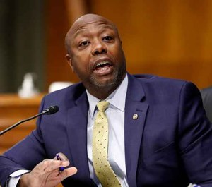 In this May 7, 2020, file photo, Sen. Tim Scott, R-S.C., speaks during a Senate Health Education Labor and Pensions Committee hearing on new coronavirus tests on Capitol Hill in Washington.