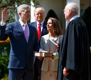 President Donald Trump watches as Supreme Court Justice Anthony Kennedy administers the judicial oath to Judge Neil Gorsuch during a re-enactment in the Rose Garden of the White House, Monday, April 10, 2017, in Washington. (AP Photo/Evan Vucci)