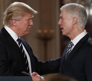 President Donald Trump shakes hands with 10th U.S. Circuit Court of Appeals Judge Neil Gorsuch, his choice for Supreme Court associate justice in the East Room of the White House in Washington, Tuesday, Jan. 31, 2017.
