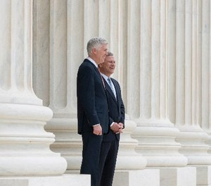 In this photo provided by the Supreme Court new Supreme Court Justice Neil Gorsuch, left, stands with Chief Justice John Roberts outside the court in Washington, Thursday, June 15, 2017, following Gorsuch formal investiture ceremony of Associate Justice.