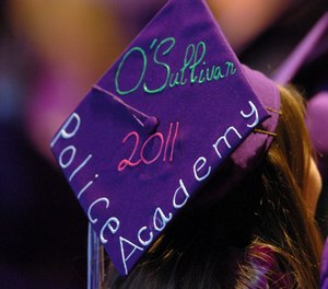 Tara O'Sullivan decorated her mortar board with her police academy plans at College Park High School's commencement ceremony in Concord, Calif. (Karl Mondon/Bay Area News Group via AP, File)