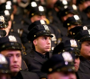 New police officers attend their graduation ceremony at the Beacon Theatre in New York, Thursday, Dec. 28, 2017.