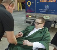 Ambulance takes patient to Fla. high school graduation