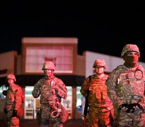 Missouri National Guard stand watch outside a Walgreens store, Wednesday, Nov. 26, 2014, in Ferguson, Mo.