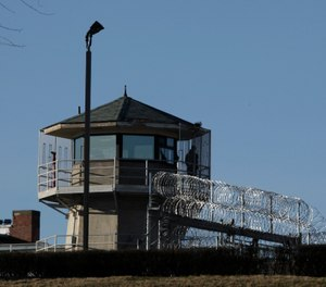 A guard stands in a tower Thursday, March 12, 2009, at the Washington State Penitentiary in Walla Walla, Wash. (AP Photo/Ted S. Warren)
