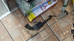 This image shows the gun recovered from a shooting that left one person dead at a Queens deli on October 26, 2020.